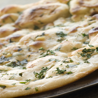 Thumb mint and garlic naan